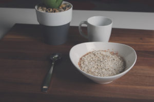 Bowl of oatmeals on timber table