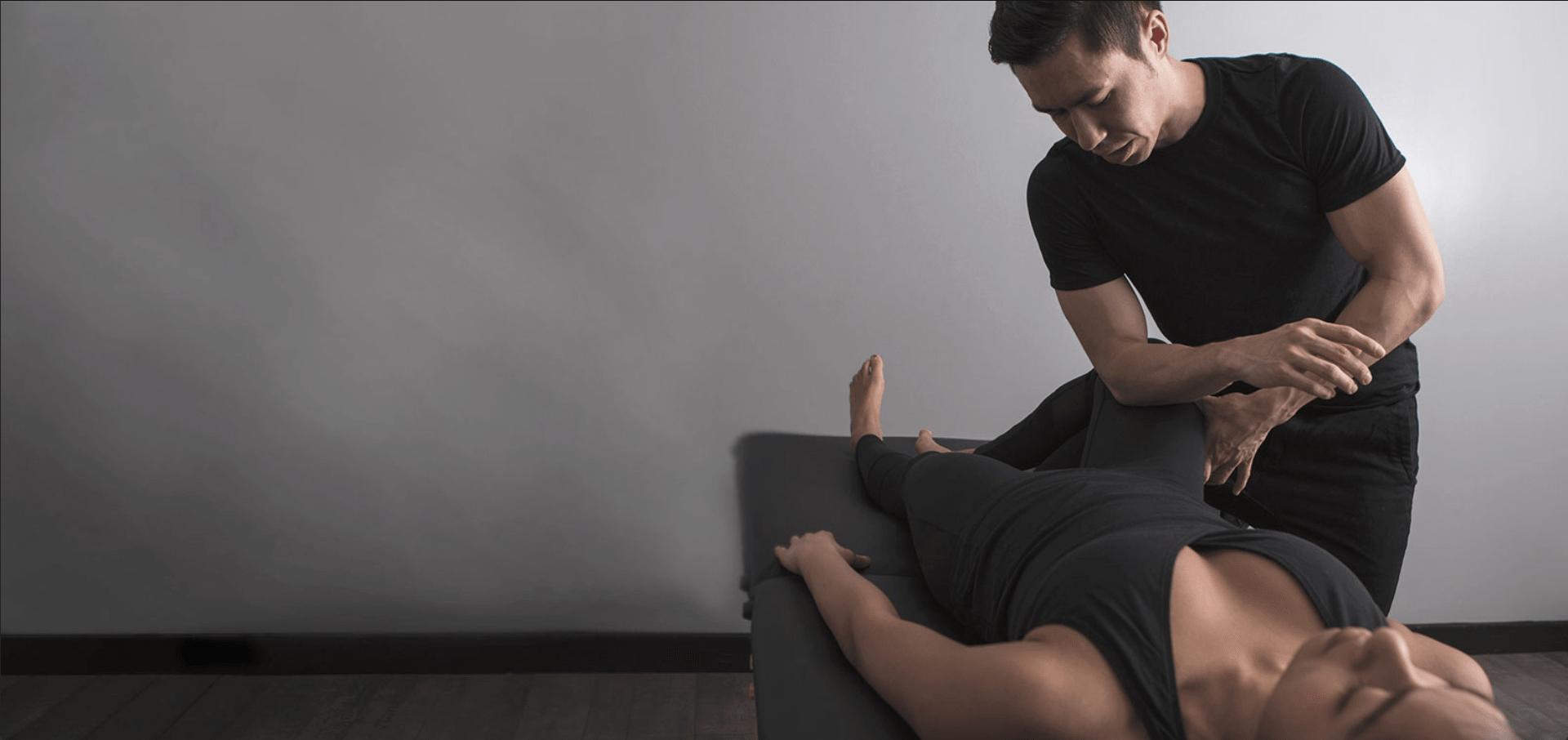 MSK chiropractor performing thigh massage